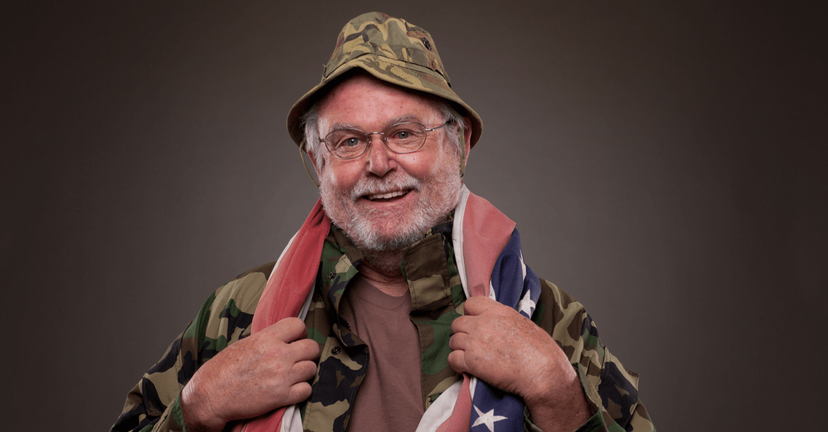 an older veteran with an American flag